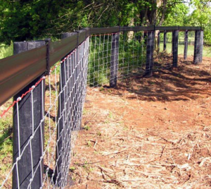 Even cattle wire can be curved. The posts in this curve have been concreted instead of being braced because of the Centaur rail on the top.