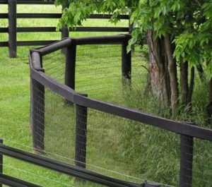 """Here is a great example of how wire fence can be curved to follow the contour of a tree line. You have to use good strong posts we like to use 9"""" round posts for any wire curve."""